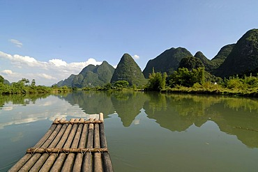 Bamboo raft on the Yulong river in the karst landscape near Yangshuo, Guilin, Guangxi, China, Asia