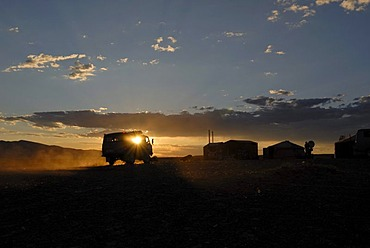 Russia last four-wheel van reaching a yurt camp or ger camp in the last sunlight, in front of the great Khorgoryn Els sand dunes in the Gobi Desert, Gurvan Saikhan National Park, Oemnoegov Aimak, Mongolia, Asia
