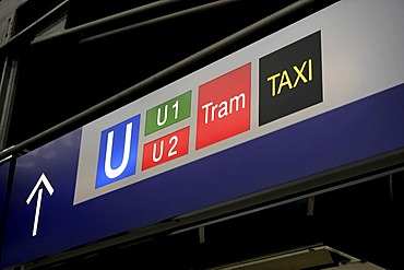 Train station sign showing directions to metro, tram and taxis, Munich, Upper Bavaria, Germany, Europe