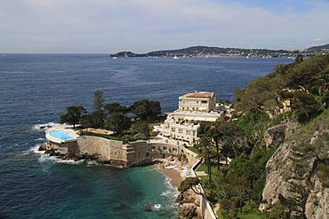 View on Saint-Jean-Cap-Ferrat, a villa with a swimming pool by the sea, Alpes Maritimes department, Provence-Alpes-Cote d'Azur region, France, Mediterranean Sea, Europe