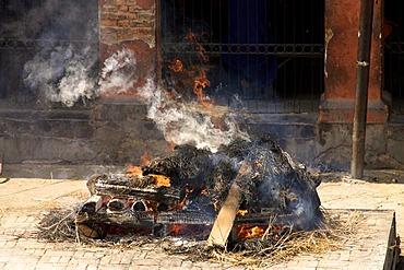 Smoking traditional cremation pyre, Pashupatinath, Nepal, Asia