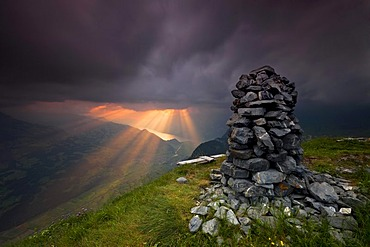 Cairn, pile of stones, sunset, the Alps, Alvier mountain range, Toggenburg valley, Switzerland, Europe