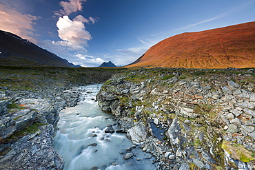 Midnight sun in the Fjaell Mountains with a stream along the Kungsleden, The King's Trail, Lapland, Sweden, Europe