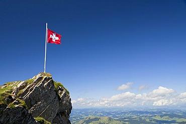 Swiss flag on a mountain in the Alpstein Range in Appenzell, Switzerland, Alps, Europe