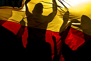 German football fans celebrating a victory behind a German flag