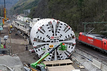 A giant tunnel boring machine of the specialist firm Herrenknecht, length 90 meters, bore diameter more than 10 meters, in front of the construction site of the second tube of the Kaiser Wilhelm Tunnel at the Ediger-Eller district, Rhineland-Palatinate, G