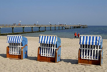 Beach chairs and pier on the beach of Kuehlungsborn on the Baltic Sea, Mecklenburg-Western Pomerania, Germany, Europe