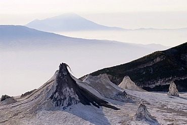 Dark magma extruding from one of the chimneys of the volcano Ol Doinyo Lengai, 2960m, Tanzania, Africa