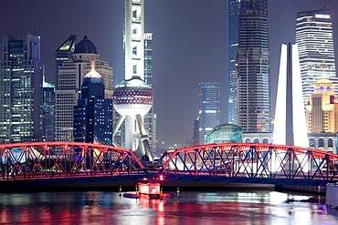 Illumined skyline at night, Waibaidu Bridge, Suzhou Creek, Lujiazui Financial District, Oriental Pearl Tower, Shanghai, China, Asia