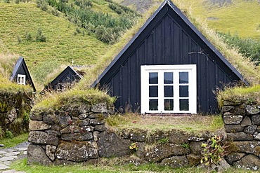 Historic houses with grass roofs in Skogar, Iceland, Europe