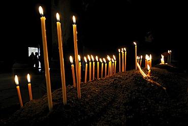 Candles burning in the Armenian orthodox church at Geghard monastery near Garni, UNESCO World Heritage Site, Kotayk region, Armenia, Asia