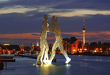 Molecule Men, sculpture by American artist Jonathan Borofsky, standing in the Spree river, overlooking the Oberbaumbruecke bridge, Osthafen harbor, Friedrichshain and tv tower, Treptow district, Berlin, Germany, Europe