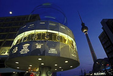 World clock on Alexanderplatz square, TV Tower and moon in the twilight, Mitte district, Germany, Europe