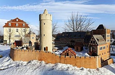 Large outdoor model of Burg Anhalt castle in the snow, Ballenstedt, northern Harz, Saxony-Anhalt, Germany, Europe