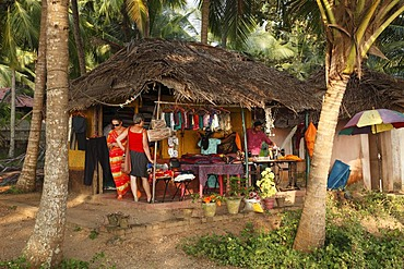 Sewing hut under palms in the south of Kovalam, Kerala state, India, Asia