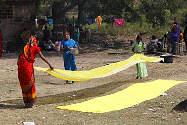 Yellow cloths being spread out, Nanjangud, Karnataka, South India, India, South Asia, Asia