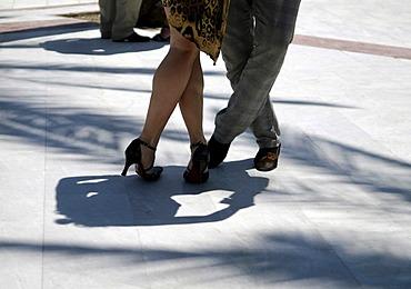 Legs of a couple dancing tango