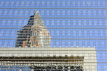 The top of the fair tower, Messeturm, and an office building reflected in the glass facade of an office skyscraper in the Frankfurt financial district, Bankenviertel, Frankfurt am Main, Hesse, Germany, Europe