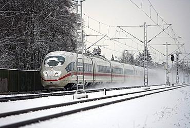 Train of the German Federal Railroad in the snow, Muehlheim, Hesse, Germany, Europe