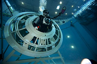 Backup divers and astronauts practicing with a space station module reproduction in a diving basin, underwater photographers are documenting the training session, European Space Agency, ESA, European Astronaut Center, EAC, Cologne, North Rhine-Westphalia,