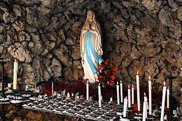 Devotional grotto with Madonna and votive candles in the courtyard of the Basilika Goessweinstein basilica, Balthasar-Neumann-Strasse 7, Goessweinstein, Upper Franconia, Bavaria, Germany, Europe