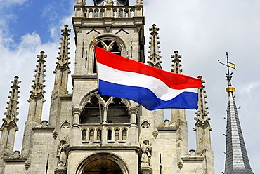 Stadhuis Gothic city hall at the market, national flag marking a public holiday or commemoration day, Gouda, Zuid-Holland, South Holland, The Netherlands, Europe