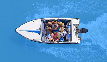 Four men in a motor boat, from above