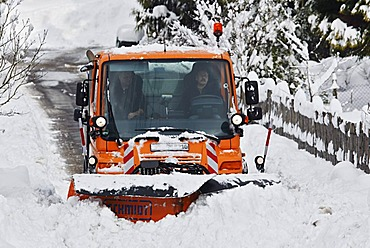 Winter road clearance, Unimog bulldozer, clearing snow, snow plough