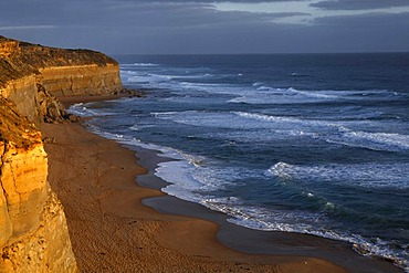 Evening light on Gibson Steps, limestone cliff and beach, Great Ocean Road, Port Campbell National Park, Victoria, Australia
