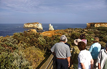 Tourists overlooking the Bay of Isles, Port Campbell National Park, Victoria, Australia