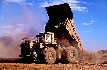 Haulpak dump truck, working with iron ore, Hamersley iron ore mine, Tom Price, Pilbara, Western Australia, Australia