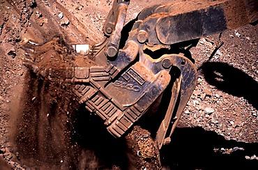 Earth shovel digging into ore, Hamersley iron ore mine, Tom Price, Pilbara, Western Australia, Australia