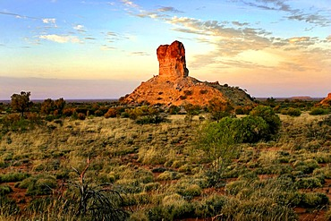 Historical pioneer landmark Chambers Pillar, 50 m high sandstone column in the red outback Australian landscape, Northern Territory, Australia