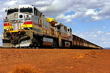GE Dash9 Diesel Train, approx 6000 horsepower, carting iron ore from Mt Tom Price to Port Dampier, Pilbara, Northwest Australia