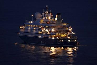 Cruise ship Sea Dream II of the SeaDream Yacht Club at night off Monaco, Principality of Monaco, the Cote d'Azur, Europe