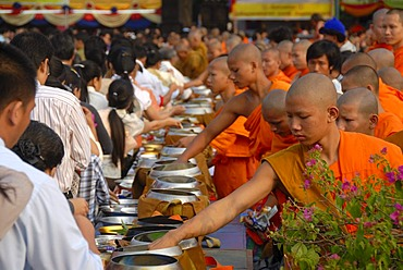 Theravada Buddhism, That Luang Festival, Tak Bat, monks standing behind alms bowls, believers, pilgrims giving alms, orange robes, Vientiane, Laos, Southeast Asia, Asia