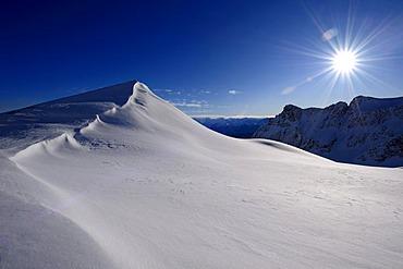 Snow cornice with blue sky and star-shaped sun, Chur, Graubuenden, Switzerland, Europe