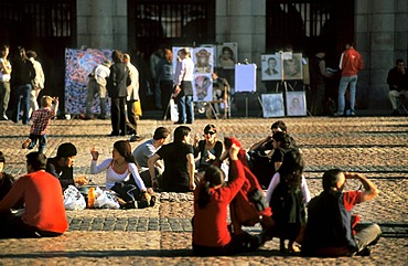 Tourists and Spaniards in the Plaza Mayor, with drawings of street artists, Madrid, Spain, Europe