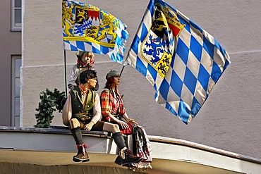 Mannequins with Bavarian flags on a roof, Munich, Bavaria, Germany, Europe