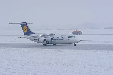 Snow, winter, Lufthansa airplane, snow removal with a jet sweeper, taxiway and runway, Munich Airport, MUC, Bavaria, Germany, Europe