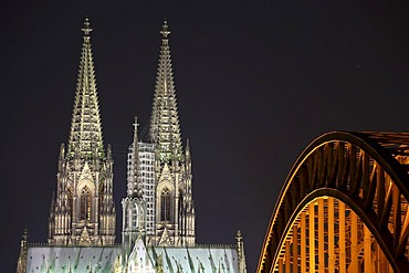 Cologne Cathedral with Hohenzollernbruecke bridge at night, Cologne, North Rhine-Westphalia, Germany, Europe