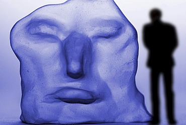 Lonely man in front of a distorted face, depression