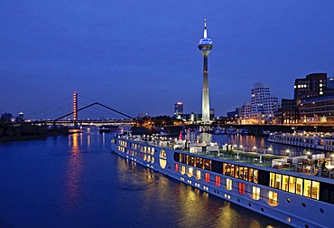A-ROSA river cruise ship leaving the Media Harbour in Duesseldorf, North Rhine-Westphalia, Germany, Europe