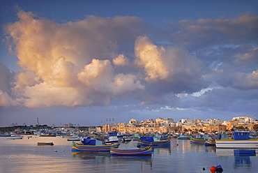 Luzzus, the typical colorful fishing boats of Malta, in Marsaxlokk Harbour, Malta, Europe