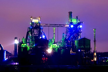 Colored lights illuminating the former smelting works in the Landschaftspark Duisburg Nord landscape park, Ruhrgebiet area, North Rhine-Westphalia, Germany, Europe