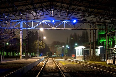 Illuminated train station in the former smelting works in the Landschaftspark Duisburg Nord landscape park, Ruhrgebiet area, North Rhine-Westphalia, Germany, Europe