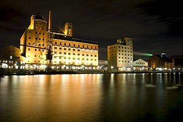 Wehrhahn-Muehle mill and Hafenforum office building in the Innenhafen Duisburg inner harbor at night, Ruhrgebiet area, North Rhine-Westphalia, Germany, Europe