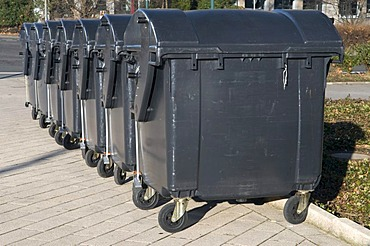Lined up garbage containers
