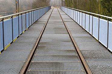 Bridge with a rails in the Landschaftspark Duisburg Nord landscape park, Ruhrgebiet area, North Rhine-Westphalia, Germany, Europe