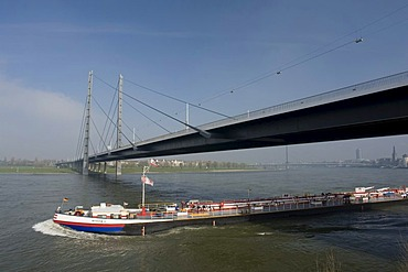 Rheinkniebruecke bridge and cargo ship, Duesseldorf, state capital of North Rhine-Westphalia, Germany, Europe